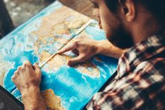 Young Hiking Man With Beard Is Planning Journey Travel With Map. Royalty Free Stock Photography