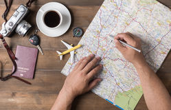 Young man planning vacation trip with map. Top view. Pointing to Thailand map royalty free stock photography