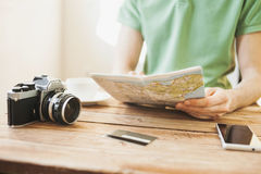 Young man planning vacation trip with travel map Royalty Free Stock Photos