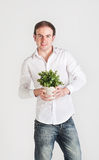 Young man with plant Stock Photography