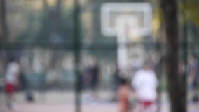 Young man play basketball streetball sport game walk toward camera Stock Images