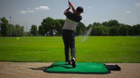 A young man play golf near the course stock video footage