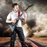 Young man play a guitar Royalty Free Stock Photos