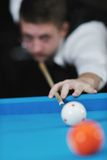 Young man play pro billiard game. Young pro billiard player finding best solution and right angle at billard or snooker pool sport game royalty free stock image