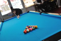 Young man play pro billiard game Royalty Free Stock Image