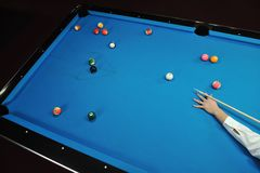 Young man play pro billiard game. Young pro billiard player finding best solution and right angle at billard or snooker pool sport game stock photography