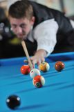 Young man play pro billiard game Royalty Free Stock Photos