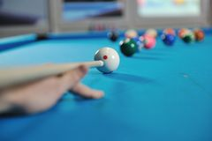 Young man play pro billiard game. Young pro billiard player finding best solution and right angle at billard or snooker pool sport game royalty free stock photo