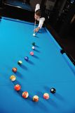 Young man play pro billiard game Stock Photos