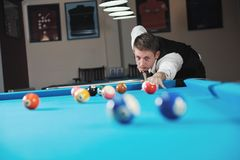 Young man play pro billiard game Royalty Free Stock Photo