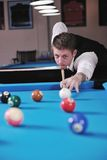 Young man play pro billiard game Stock Photo