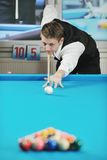 Young man play pro billiard game. Young pro billiard player finding best solution and right angle at billard or snooker pool sport game stock image
