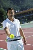 Young man play tennis Stock Photos