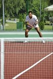 Young man play tennis outdoor Stock Image