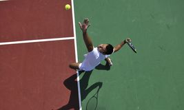 Young man play tennis outdoor Royalty Free Stock Photos