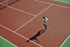 Young man play tennis outdoor Stock Photo