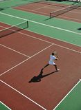 Young man play tennis outdoor Stock Photos