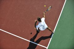 Young man play tennis outdoor Royalty Free Stock Photography