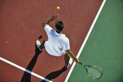 Young man play tennis outdoor Stock Photography