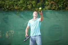 Young man play tennis outdoor on orange court stock photos