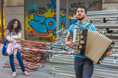 Young man playing the accordion Stock Photography