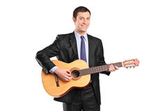 A young man playing acoustic guitar Stock Image
