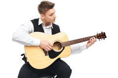 Young man playing on acoustic guitar Stock Photography