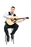 Young man playing on acoustic guitar Royalty Free Stock Photography