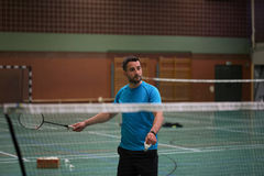 Young man playing badminton. A young man playing badminton Royalty Free Stock Photo