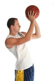 Young man playing basketball Stock Images