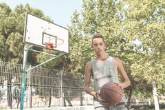 Young man playing basketball Stock Image