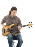 Young man is playing a bass guitar. Bass guitarist playing his bass guitar (Series with the same model available Stock Photos