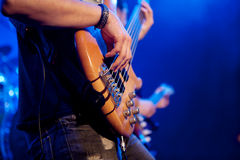 Young man playing bass live. Body. Royalty Free Stock Photos