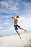 A young man playing beach volleyball Stock Photo