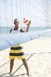 Young Man Playing Beach Volleyball Royalty Free Stock Images