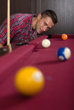 Young man playing billiard,without friends Royalty Free Stock Photography