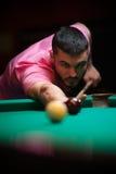 Young man playing billiard game at pub Stock Photos