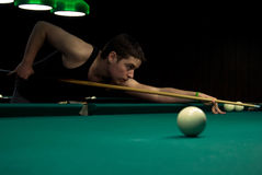 Young man playing billiards Stock Photography