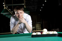 Young man playing billiards Royalty Free Stock Photography
