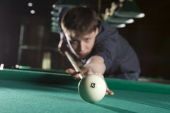 Young man playing billiards Royalty Free Stock Photos