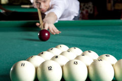 Young man playing billiards Stock Photo