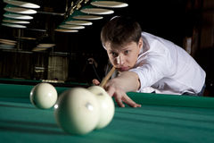 Young man playing billiards Royalty Free Stock Images