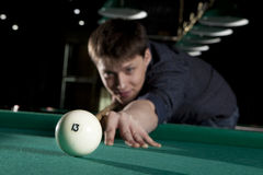 Young man playing billiards Royalty Free Stock Photo