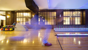 Young man playing bowling Stock Images