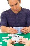 Young man playing cards cuarenta traditional Royalty Free Stock Image