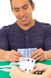 Young man playing cards cuarenta traditional Stock Photography