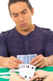 Young man playing cards cuarenta traditional Royalty Free Stock Photography