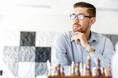 Young man playing chess Royalty Free Stock Image
