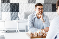 Young man playing chess Stock Image
