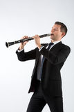 Young man playing the clarinet Stock Images